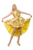 Madame dans la robe jaune avec du charme sur le blanc Photo libre de droits