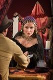 Madame Dealing Tarot Cards Photos stock