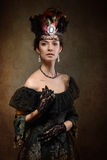 Madame utilisant une couronne image libre de droits