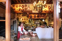 A lady is making omelettes at the mont saint-michel stock image