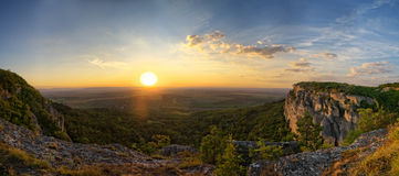Madara fortress, Bulgaria. Picture was taken on Madara hill, near Shumen, Bulgaria. There is medieval fortress on the rocks and Madara village in the background Stock Photos