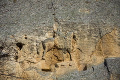 Madara Rider, Bulgaria. Madara Rider or Madera Horseman rock carving in relief formation in Bulgaria on sunny day Royalty Free Stock Photo