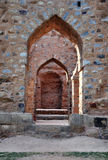 Madarasa or College and Khalji's tomb. The image includes typical arches and structure of buildings. The building served a dual purpose- it was both a madarasah Royalty Free Stock Images