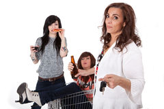 MADD Mothers Against Drunk Driving. Sober mother taking car keys away from drunk party girls Royalty Free Stock Photo