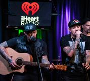 The Madden Brothers Perform at Q102 in Bala Cynwyd, PA, USA Royalty Free Stock Image