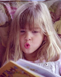Maddie reading. A 5-year-old reading a book Royalty Free Stock Photography