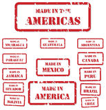 Made In America Stamps. Set of red rubber stamps of Made In symbols for North, Central and South America Stock Images