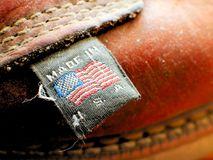 Made in America USA United States Apparel Tag on Leather Boot. Made in America USA United States Apparel Tag on Vintage Leather Boot stock photo