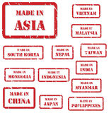 Made In Asia Stamps. Set of red rubber stamps of Made In symbols for Asia vector illustration