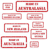 Made In Australasia Stamps. Set of red rubber stamps of Made In symbols for Australasia region Stock Photos