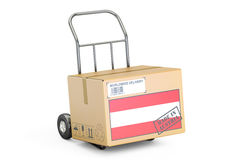 Made in Austria concept. Cardboard Box on Hand Truck, 3D renderi Stock Images