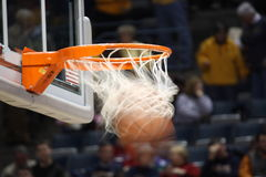 Made Basket. Basket ball going through the rim and net to complete the shot Royalty Free Stock Images