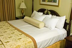 Made bed. Made up motel or hotel bed Royalty Free Stock Image
