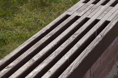 Wooden bench park. Made of boards painted with paint old wooden bench in a city park, close-up and details of a piece of construction royalty free stock photography