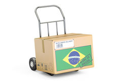 Made in Brazil concept. Cardboard Box on Hand Truck, 3D renderin Stock Photos