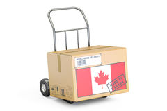 Made in Canada concept. Cardboard Box on Hand Truck, 3D renderin Stock Photo