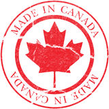 Made in Canada Decal. Vector image of a Made in Canada decal simulating a rubber stamp stock illustration