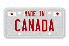 Made in Canada License Plate. The words Made in Canada in red on license plate isolated on white, Made in Canada License Plate Stock Images