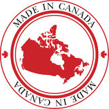 Made in Canada Stamp. Made in Canada circular  stamp featuring maple leaf and map of Canada in official Canada flag colors Royalty Free Stock Images