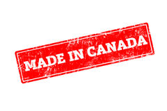 MADE IN CANADA. Word written on red rubber stamp with grunge edges Royalty Free Stock Images