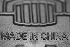 Made in China. Sign MADE IN CHINA on black background Royalty Free Stock Photo