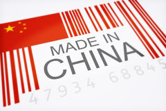 Made in China. Product bar code symbolizing the massive amounts of imported goods from China isolated on a white background Royalty Free Stock Photos
