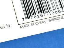 Made in China on a box. The prase Made in China on a paper packaging box Stock Photos