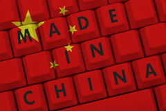 Made in China. The Chinese flag on a computer keyboard with text Royalty Free Stock Images