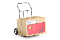 Made in China concept. Cardboard Box on Hand Truck, 3D rendering Stock Photography