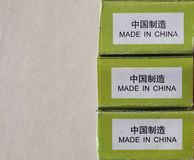 Made in China label with copy space. Made in China label written on a packet in English and in Simplified Chinese with copy space Stock Images