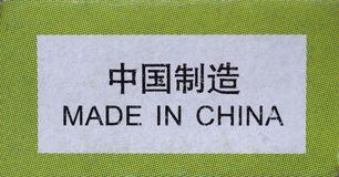 Made in China label. Written on a packet in English and in Simplified Chinese Stock Photos