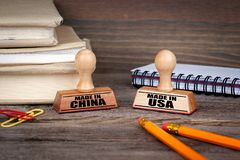 Made in china and made in usa. Rubber Stamp on desk in the Office. Business and work background Royalty Free Stock Images