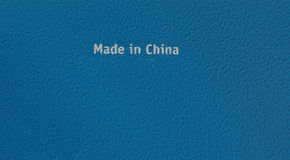 Made in china on steel plate. Made in china written on a blue steel plate background Royalty Free Stock Photography