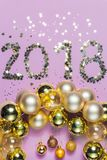 2018 made of confetti with glass Christmas ornaments Stock Photography