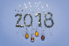 2018 made of confetti in the shape of stars with Christmas decorations Stock Images