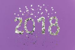 2018 made of gold and silver confetti in the shape of stars Royalty Free Stock Photos