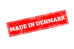 MADE IN DENMARK. Word written on red rubber stamp with grunge edges Royalty Free Stock Photography