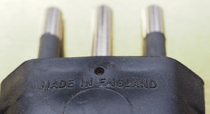 Made in England label. On a European electrical plug royalty free stock photography