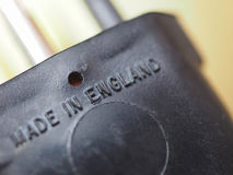 Made in England label. On a European electrical plug stock photo