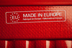 Made in europe sign on red carbon texture Stock Photo