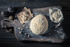 Made of fresh ingredients delicious and traditionally dough for bread. On old wooden table Royalty Free Stock Photos