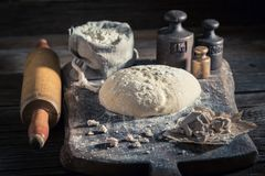 Made of fresh ingredients traditionally and delicious dough for bread. On old wooden table Stock Photography