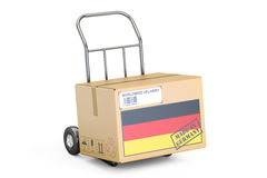 Made in Germany concept. Cardboard Box on Hand Truck, 3D. Rendering on white background Stock Image