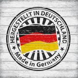 Made in Germany. Stamp on wooden background Stock Photography