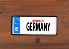 Made in Germany. On a wooden board metal plate with european uni Stock Photography