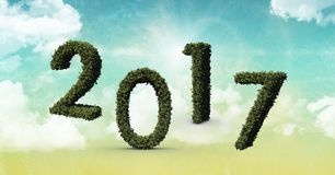 2017 made of green grass against composite image 3D of sky. 2017 made of green grass against composite image 3D of blue sky Stock Photo