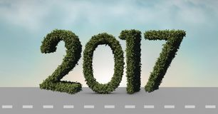 2017 made of green grass on composite image 3D of road. In sky Royalty Free Stock Images