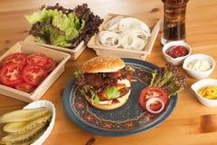 Made hamburger itself. Hamburger homemade, freshly prepared with many ingredients Stock Image
