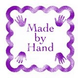 Made by a Hand rubber stamp Royalty Free Stock Image