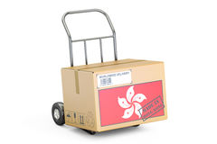 Made in Hong Kong concept. Cardboard Box on Hand Truck, 3D rende Stock Photos